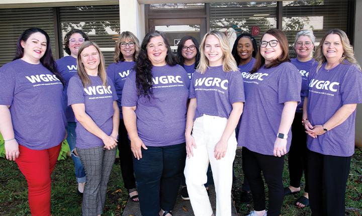 WGRC staff wearing purple shirts