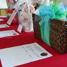 Gift baskets and bid sheets on the silent auction table
