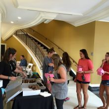 A line forms at the Angel Cakes table